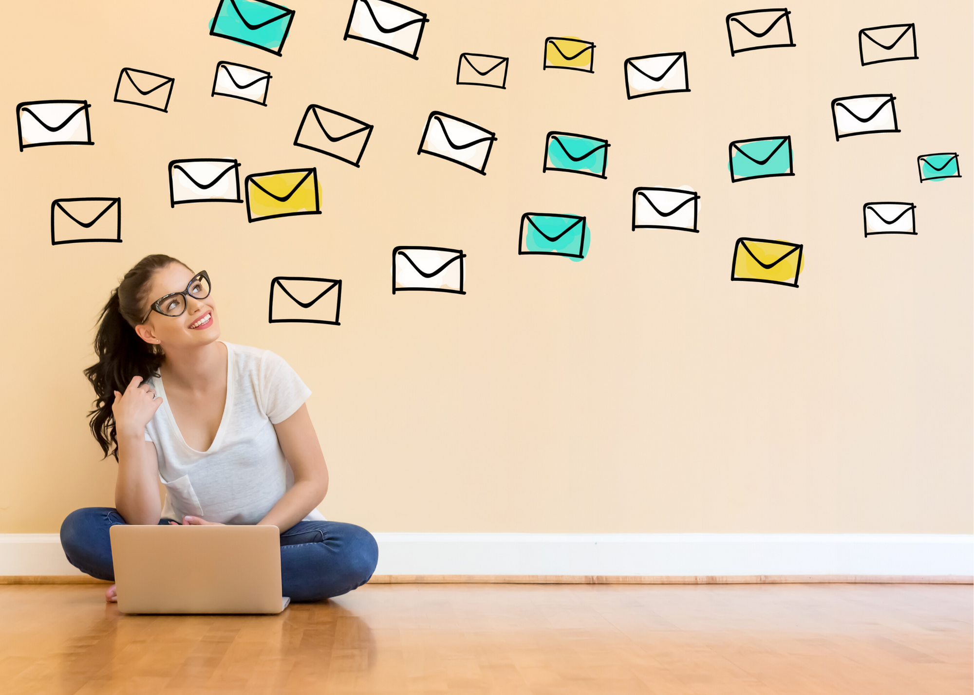 girl looking at emails smiling
