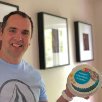 "Jean-François Dion with his ""Mission migration: Success!"" cake."